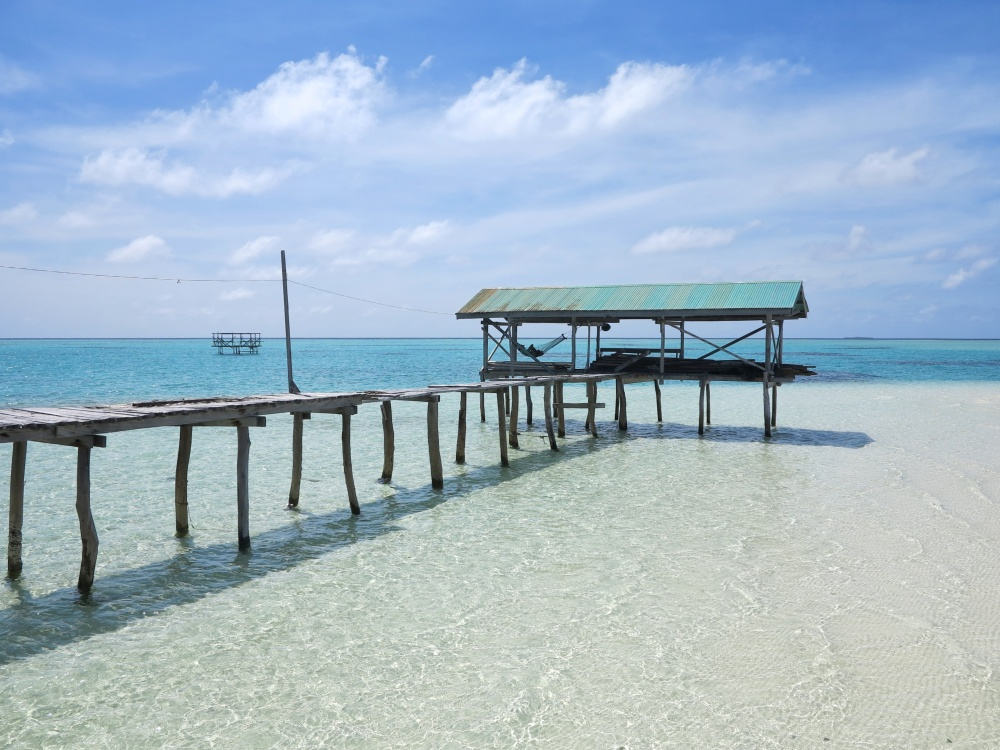 The clear waters and fine, white sand of Onok compliment the wooden structures built in it.