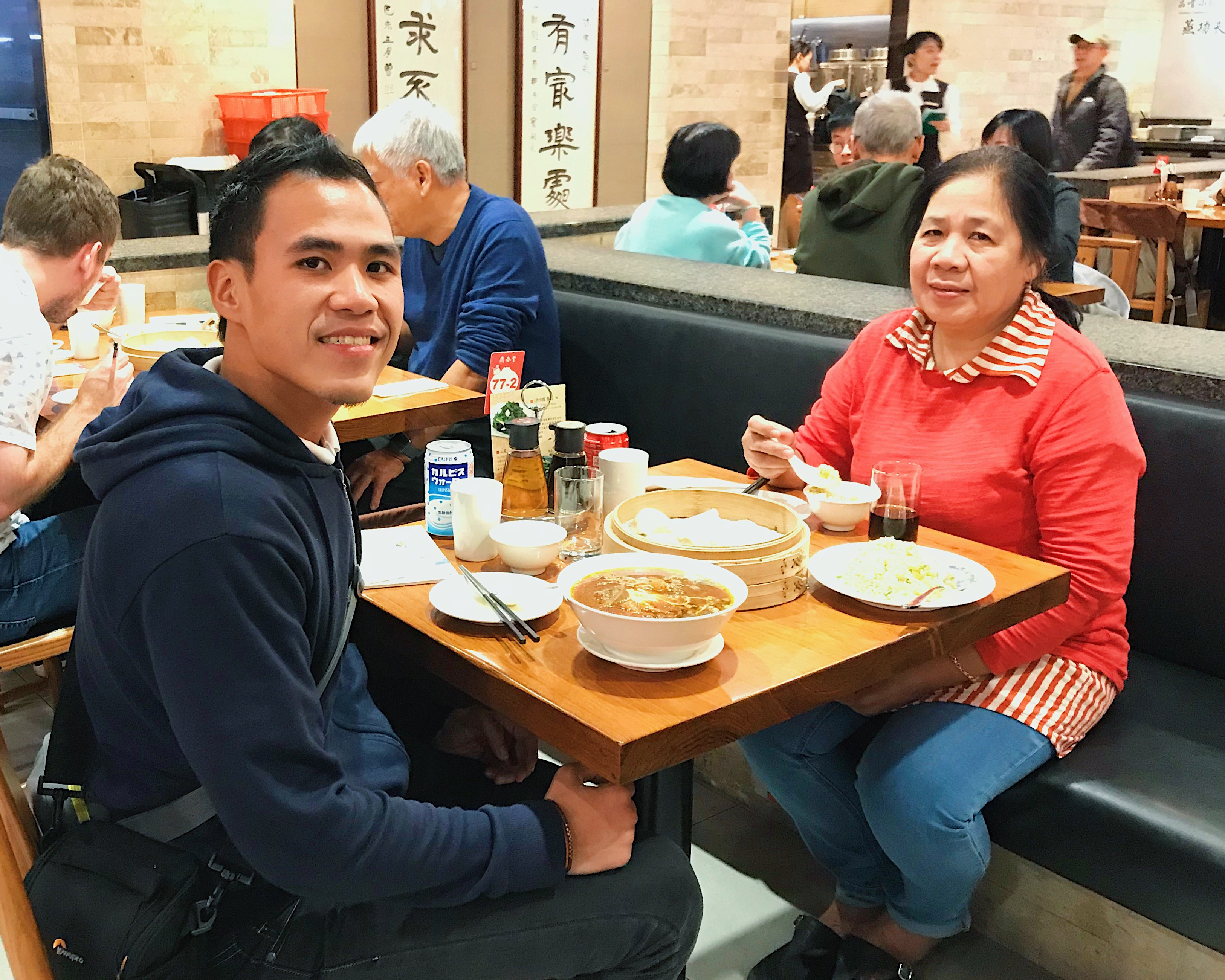 DIN TAI FUNG. Here's my Mama and I as we are enjoying Din Tai Fung's xiaolongbao and beef noodles.