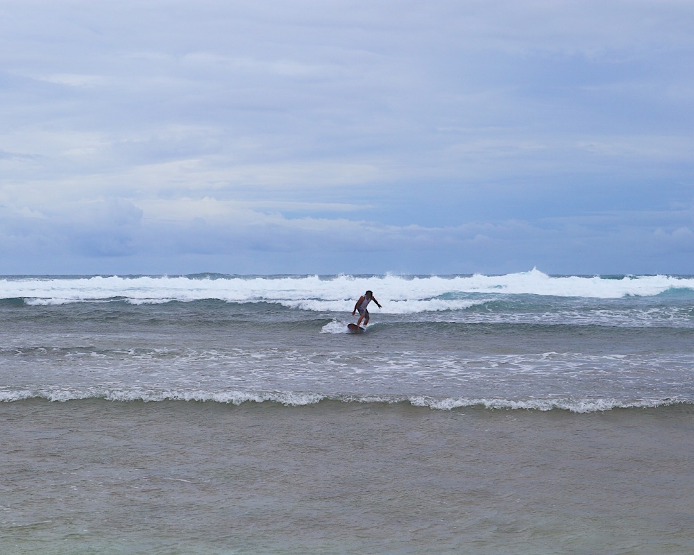 A surfer tries the waves of Guiuan.