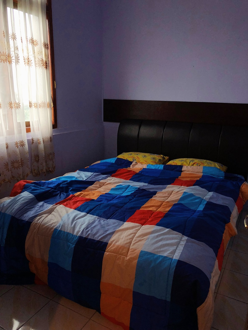 COMFY BED IN BROWN OTIX GUEST HOUSE.