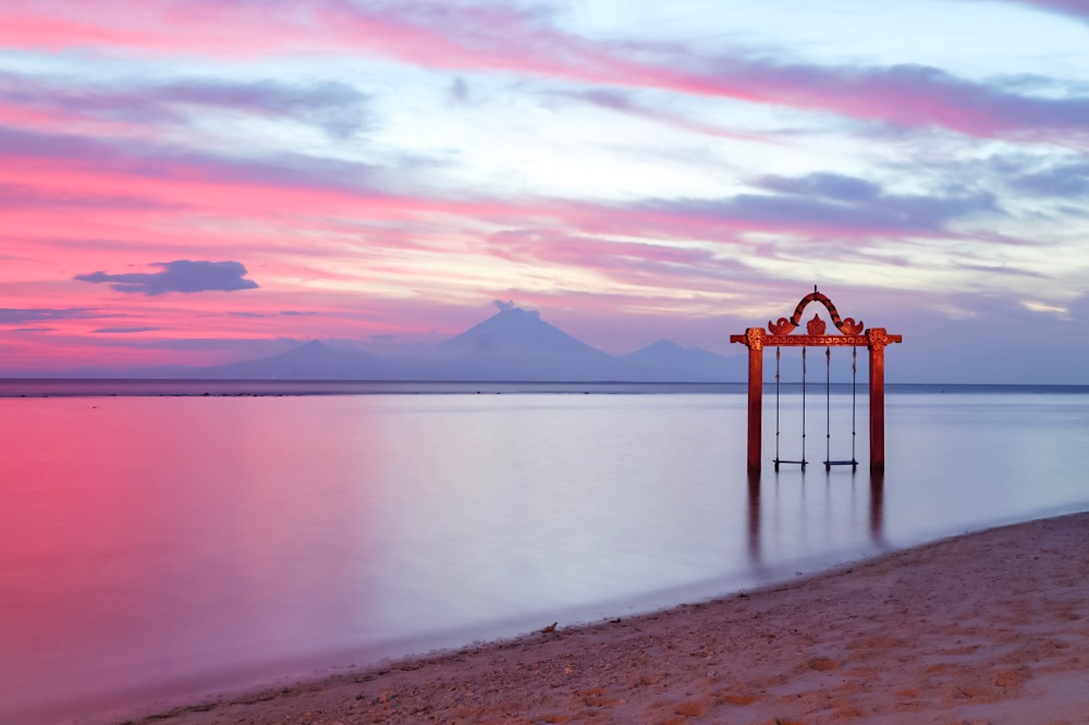 SUNSET IN LOMBOK. Ombak Swing with Mt. Agung at the background.