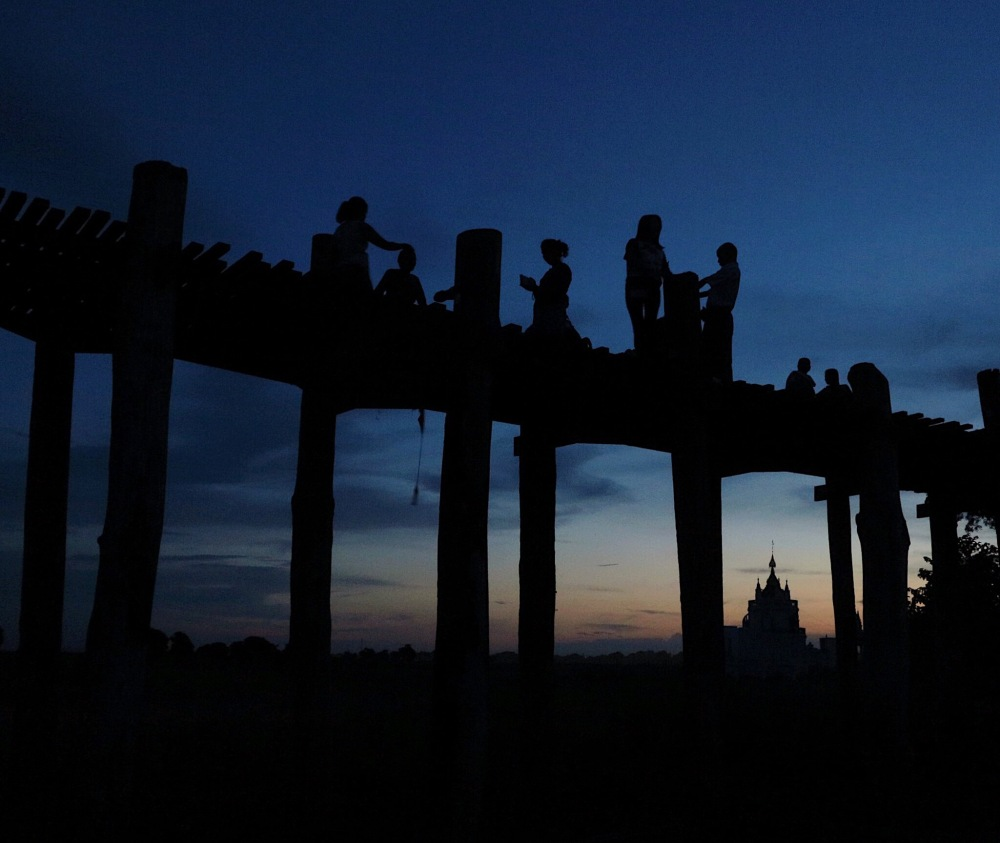 U BEIN BRIDGE AT SUNSET.