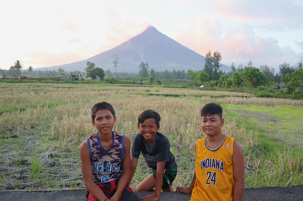 BOYS OF LEGAZPI. Here are Steven (middle), Roger (left) and Julius (right) whom I have met while exploring the Cagsawa Ruins.