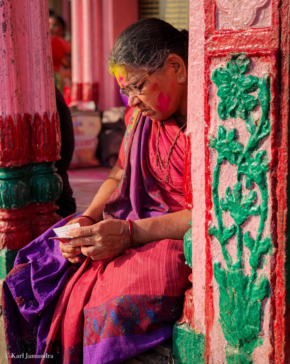 A HINDU WOMAN PRAYING.